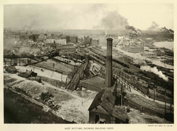 "West Bottoms Union Depot – 1899 JPEG – View of the West Bottoms and its thriving livestock industry captured from Quality Hill in 1899. Union Depot can be seen on the left just above the 9th Street Incline. Also in view are the typical ""roughhewn"" houses that would have dotted the West Bluffs during this time. Missouri Valley Special Collections, Kansas City Public Library, 1899."