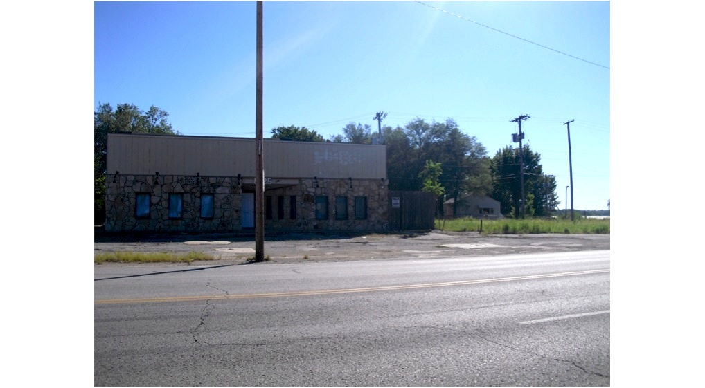 Founded in 1957 near present-day 71 Hwy and Prospect Avenue, here lies the remains of the original Smokestack Bar-B-Q, owned and operated by the parents of restauranteur Jack Fiorella, who opened his popular Jack Stack barbecue restaurant in Martin City in 1974.